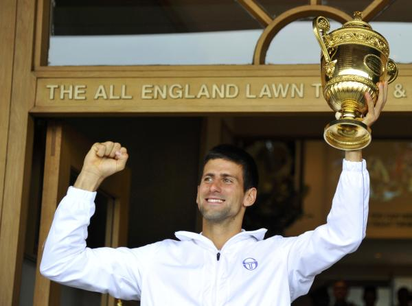 Djokovic Proudly Showing off his new Trophy