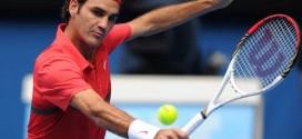 Federer schools Tomic