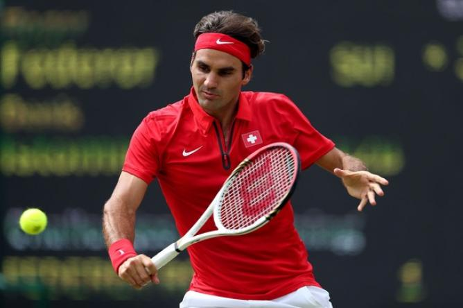 Photo of Federer Beats Istomin to Make Quarter Finals