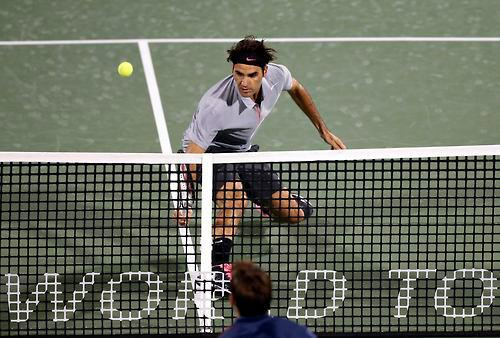 Federer Tracking Down a Drop Shot